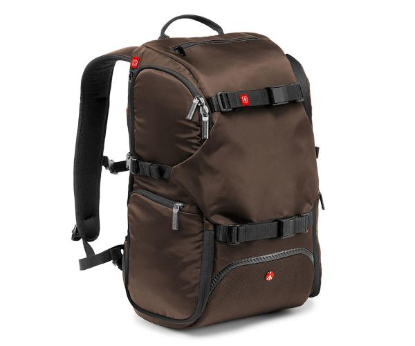 Nikon Manfrotto Рюкзак для фотоаппаратуры Travel Backpack (коричневый)Чехлы, кофры<br>В путешествиях рюкзак - это идеальное решение для фотографа, который хочет иметь при себе все, что нужно: фотоаппарат, штатив аксессуары и личные вещи. Все может прекрасно уместиться в один единственный компактный рюкзак, который легко и удобно но...<br><br>Тип: Рюкзак для фотоаппаратуры<br>Цвет корпуса: Коричневый