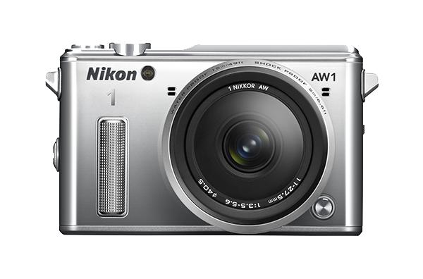 Nikon   1 AW1 Kit 11-27.5mm f/3.5–5.6 СеребристыйФотокамеры NIKON 1<br>Водонепроницаемая, ударопрочная, морозостойкая и удивительно быстрая фотокамера Nikon 1 AW1 никогда вас не подведет. Куда бы вы ни отправились — на горнолыжный курорт, в путешествие на яхте или на захватывающее сафари, эта системная фотокамера всегда ...<br><br>Тип: Цифровая фотокамера, поддерживающая использование сменных объективов<br>Формат матрицы: CX<br>Тип матрицы, размер: КМОП: 13,2 x 8,8 мм<br>Эффективное число пикселей: 14,2 млн<br>Процессор (АЦП): EXPEED 3a<br>Чувствительность ISO: От 160 до 6400 единиц ISO с шагом 1 EV (задается пользователем в режимах P, S, A и M)<br>Автофокусировка: Гибридная автофокусировка (одноточечная АФ: 135 зон фокусировки; центральные 73 зоны поддерживают АФ с определением фазы Автоматический выбор зоны АФ: 41 зона фокусировки)<br>Режим зоны автофокуса: Одноточечная АФ, одноточечная АФ (по центру), автоматический выбор зоны АФ, ведение объекта<br>Выдержка синхронизации: Не менее 1/60 с (электронный затвор)<br>Режимы съемки: Авто; творческий режим с возможностью выбора таких параметров: P, S, A, M, Под водой, Ночной пейзаж, Ночной портрет, Освещение сзади, Простая панорама, Фильтр сглаживания, Эффект миниатюры и Выборочный цвет; Съемка лучшего момента (Замедленный просмотр и Интеллектуальный выбор снимка), Расширенный режим видео (HD — только в режимах P, S, A, M и «Замедленная съемка»), Моментальный снимок движения<br>Контроль экспозиции: Авто; творческий режим с возможностью выбора таких параметров: P, S, A, M, Под водой, Ночной пейзаж, Ночной портрет, Освещение сзади, Простая панорама, Фильтр сглаживания, Эффект миниатюры и Выборочный цвет; Съемка лучшего момента (Замедленный просмотр и Интеллектуальный выбор снимка), Расширенный режим видео (HD — только в режимах P, S, A, M и «Замедленная съемка»), Моментальный снимок движения<br>Коррекция экспозиции: От -3 до +3 EV с шагом 1/3 EV<br>Баланс белого: Авто, под водой, лампа накаливания, лампа дневного света, п
