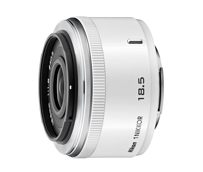 Nikon  1 NIKKOR 18.5mm f/1.8 БелыйСтандартные<br>Жизнь, наблюдаемая сквозь светосильный объектив, всегда прекрасна.<br> <br> Прекрасно дополняя систему Nikon 1, легкий и компактный объектив 1 NIKKOR 18,5 мм с высокой светосилой f/1,8 позволяет свободно делать отличные снимки и видеоролики в любое время...<br><br>Тип: С фиксированным фокусным расстоянием<br>Фокусное расстояние: 18,5 мм (50 мм в формате 35 мм)<br>Максимальная диафрагма: 1.8<br>Минимальная диафрагма: 16<br>Подавление вибраций: Нет<br>Конструкция объектива: 8 элементов в 6 группах (включая 1 асферическую линзу)<br>Угол зрения: СX: 46°40<br>Минимальное расстояние фокусировки: 0.2<br>Количество лепестков диафрагмы: 7<br>Установочный размер фильтра: 40,5 мм<br>Цвет корпуса: Белый