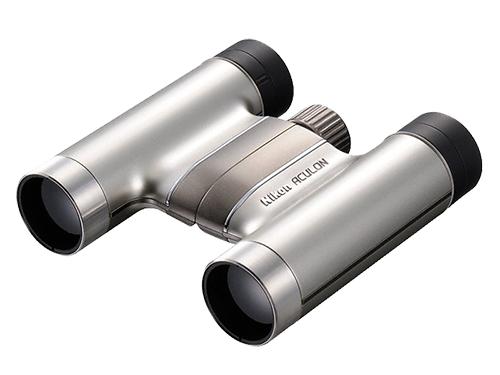 Nikon  Бинокль ACULON T51 10X24 СеребристыйБинокли компактные<br>Бинокль ACULON T51 отличается не только кристально четким изображением, но еще и стильным дизайном и невероятно малым весом. Модель ACULON T51 10x24 выпускается в черном и серебристом исполнении с элегантным алюминиевым напылением. Благодаря тонкой и ...<br><br>Тип: Бинокль Aculon<br>Диаметр объектива (мм): 24<br>Влагозащищенность: Нет<br>Увеличение (x): 10<br>Выходной зрачок (мм): 2.4<br>Вынос точки визирования (мм): 10.6<br>Относительная яркость: 5.8<br>Минимальное расстояние фокусировки (м): 2.5<br>Реальный угол зрения (°): 5.3<br>Регулировка расстояния между центрами окуляров (мм): 56-72<br>Тип призмы: Roof<br>Питание: Нет<br>Цвет корпуса: Серебристый