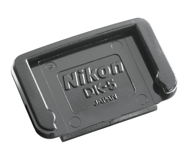 Nikon Крышка окуляра DK-5Аксессуары для визирования<br>При использовании автоспуска или дистанционного спуска рекомендуется снимать наглазник с окуляра видоискателя и надевать крышку окуляра DK-5. Это исключит влияние света, попадающего через видоискатель, на операцию автоматической установки экспозиции.<br> <br> Совместим с зеркальными фотокамерами: F80, F75, F65, F55, D40, D40X, D60, D3000, D3100, D3200, D3300, D5000, D5100, D5200, D5300, D5500, D50, D70, D70S, D80, D90, D100, D200, D300, D300S, D750, D600, D610<br><br>Тип: Резиновый наглазник<br>Артикул: FXA10193