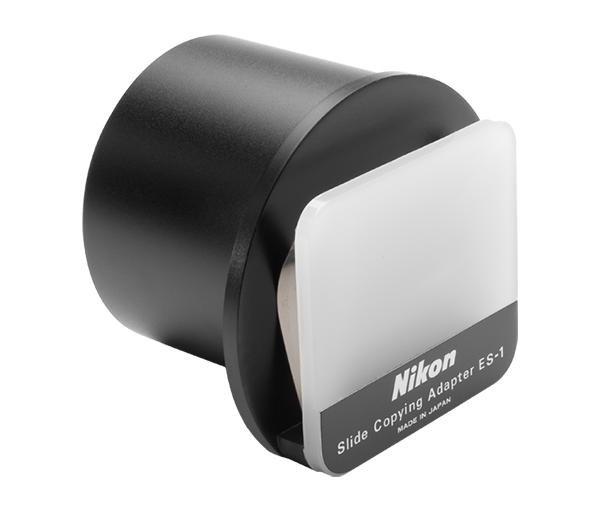 Nikon ES-1 Насадка для пересъемки слайдовАксессуары для макро съемки<br>Совместимые продукты: <br><br>55mm f/2.8 Micro-Nikkor <br>60mm f/2.8D AF Micro-Nikkor <br>Переходное кольцо BR-5 <br>Удлиннительное кольцо PK-13<br>Фокусировочный мех PB-6<br><br>Тип: Насадка для пересъемки слайдов<br>Артикул: FHW00301